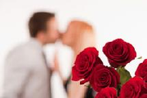 couple kissing with roses