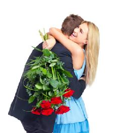 Woman hugging man with Red roses